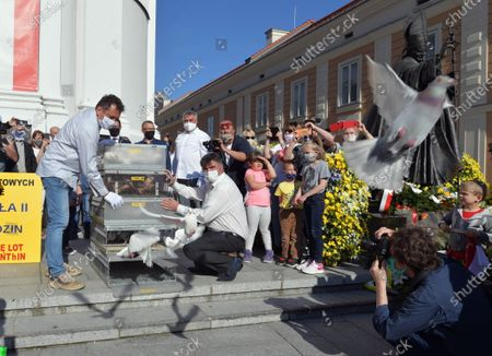 Stock Photo of Residents of Wadowice participate in action '100 pigeons for the century' during the celebrations the 100th birth anniversary of the Pope John Paul II in Wadowice, Poland, 18 May 2020. Pope John Paul II was born as Karol Jozef Wojtyla on 18 May 1920 in Wadowice. He was head of the Catholic Church and sovereign of the Vatican City State from 1978 to 2005, and canonised on 27 April 2014.