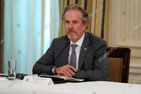 Stock Picture of Thomas Keller, chef and owner of Thomas Keller Restaurant Group, listens during a meeting with restaurant industry executives about the coronavirus response, in the State Dining Room of the White House, in Washington