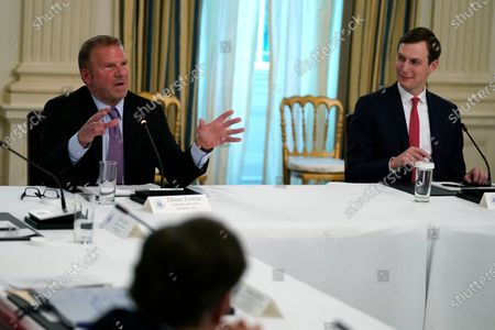 Stock Photo of Tilman Fertitta, chairman and CEO of Landry's Inc., speaks during a meeting with restaurant industry executives about the coronavirus response, in the State Dining Room of the White House, in Washington, as White House senior adviser Jared Kushner listens