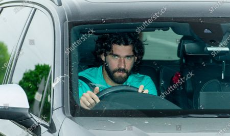 Liverpool's goalkeeper Alisson Becker arrives for a training session to the Melwood training facility in Liverpool, Britain, 19 May 2020. English Premier League clubs resumed training activities in small groups amid the ongoing SARS-CoV-2 coronavirus pandemic which causes the COVID-19 disease.