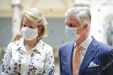 Queen Mathilde and King Philippe with mouth masks