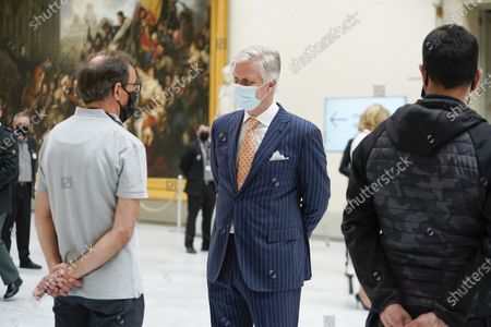 King Philippe with a mouth mask