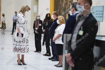 Queen Mathilde with a mouth mask
