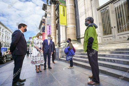 Queen Mathilde, King Philippe and Michel Draguer with mouth masks