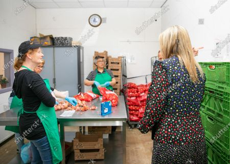 Stock Picture of Queen Maxima during a working visit to the distribution center of the Food Bank Delft. The Delft Food Bank Foundation wants to contribute to the fight against poverty by distributing weekly food packages to people who are (temporarily) in financial need.The visit takes place in the context of the outbreak of the corona virus (COVID-19).