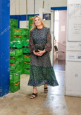 Stock Photo of Queen Maxima during a working visit to the distribution center of the Food Bank Delft. The Delft Food Bank Foundation wants to contribute to the fight against poverty by distributing weekly food packages to people who are (temporarily) in financial need.The visit takes place in the context of the outbreak of the corona virus (COVID-19).