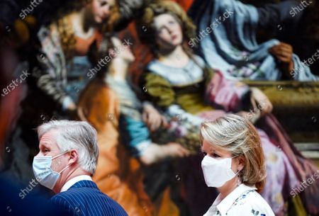 Belgium's King Philippe, left, and Belgium's Queen Mathilde, wear a face mask to prevent the spread of coronavirus, as they visit the Royal Museum of Fine Arts in Brussels, . Museums are hesitantly starting to reopen as the coronavirus lockdown measures are relaxed, yet experts say that one in eight in the world could potentially face permanent closure because of the pandemic