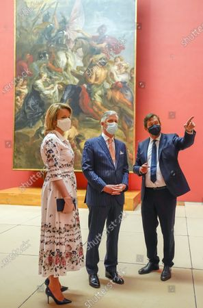 Belgium's King Philippe, center, and Belgium's Queen Mathilde, left, wear a face mask to prevent the spread of coronavirus, as they visit the Royal Museum of Fine Arts in Brussels, . Museums are hesitantly starting to reopen as the coronavirus lockdown measures are relaxed, yet experts say that one in eight in the world could potentially face permanent closure because of the pandemic