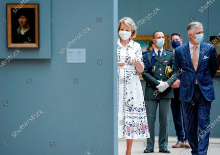Belgium's King Philippe, right, and Belgium's Queen Mathilde, left, wear a face mask to prevent the spread of coronavirus, as they visit the Royal Museum of Fine Arts in Brussels, . Museums are hesitantly starting to reopen as the coronavirus lockdown measures are relaxed, yet experts say that one in eight in the world could potentially face permanent closure because of the pandemic