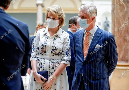 Belgium's King Philippe, right, and Belgium's Queen Mathilde, center, wear a face mask to prevent the spread of coronavirus, as they visit the Royal Museum of Fine Arts in Brussels, . Museums are hesitantly starting to reopen as the coronavirus lockdown measures are relaxed, yet experts say that one in eight in the world could potentially face permanent closure because of the pandemic