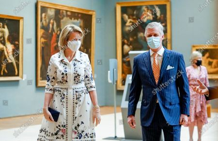 Belgium's King Philippe, second right, and Belgium's Queen Mathilde, left, wear a face mask to prevent the spread of coronavirus, as they visit the Royal Museum of Fine Arts in Brussels, . Museums are hesitantly starting to reopen as the coronavirus lockdown measures are relaxed, yet experts say that one in eight in the world could potentially face permanent closure because of the pandemic