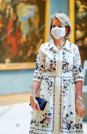 Belgium's Queen Mathilde wears a face mask, to prevent the spread of coronavirus, as she visit the Royal Museum of Fine Arts in Brussels, . Museums are hesitantly starting to reopen as the coronavirus lockdown measures are relaxed, yet experts say that one in eight in the world could potentially face permanent closure because of the pandemic