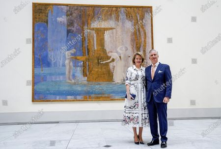 Belgium's King Philippe, right, and Belgium's Queen Mathilde pose for a photographer as they visit the Royal Museum of Fine Arts in Brussels, . Museums are hesitantly starting to reopen as the coronavirus lockdown measures are relaxed, yet experts say that one in eight in the world could potentially face permanent closure because of the pandemic