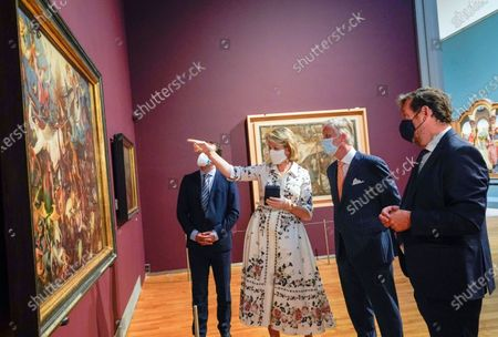 Belgium's King Philippe, second right, and Belgium's Queen Mathilde, second left, wear a face mask to prevent the spread of coronavirus, as they visit the Royal Museum of Fine Arts in Brussels, . Museums are hesitantly starting to reopen as the coronavirus lockdown measures are relaxed, yet experts say that one in eight in the world could potentially face permanent closure because of the pandemic