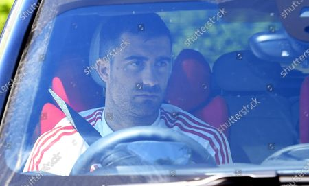 Stock Photo of Arsenal's Sokratis Papastathopoulos arrives at the English Premier League side's training complex at London Colney, near St Albans, Britain, 19 May 2020. English Premier League clubs resumed training activities in small groups as Britain's lockdown eases amid the ongoing SARS-CoV-2 coronavirus pandemic which causes the COVID-19 disease.