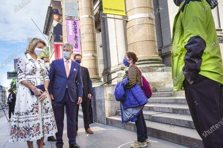 Belgium Queen Mathilde (L) and Belgium King Philippe (C) wear face masks as they talk to first visitors during a visit of the Royal Museum of Fine Arts of Belgium at the first day of re-opening amid the coronavirus crisis in Brussels, Belgium, 19 May 2020. Belgium eased lockdown measures in place to curb the spread of the COVID-19 pandemic, caused by the novel coronavirus.