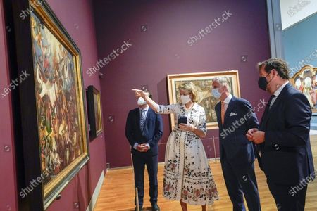 Belgium Queen Mathilde (C) and Belgium King Philippe (2-R) wear face masks during a visit of the Royal Museum of Fine Arts of Belgium at the first day of re-opening amid the coronavirus crisis in Brussels, Belgium, 19 May 2020. Belgium eased lockdown measures in place to curb the spread of the COVID-19 pandemic, caused by the novel coronavirus.