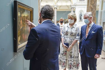 Belgium Queen Mathilde (C) and Belgium King Philippe (R) wear face masks during a visit of the Royal Museum of Fine Arts of Belgium at the first day of re-opening amid the coronavirus crisis in Brussels, Belgium, 19 May 2020. Belgium eased lockdown measures in place to curb the spread of the COVID-19 pandemic, caused by the novel coronavirus.