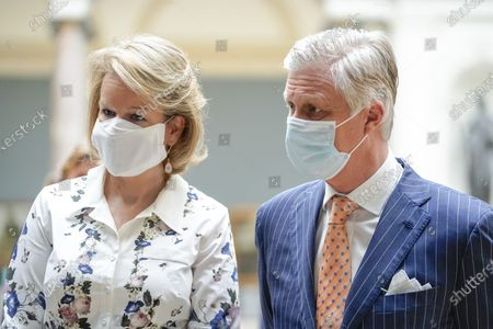 Belgium Queen Mathilde (L) and Belgium King Philippe wear face masks during a visit of the Royal Museum of Fine Arts of Belgium at the first day of re-opening amid the coronavirus crisis in Brussels, Belgium, 19 May 2020. Belgium eased lockdown measures in place to curb the spread of the COVID-19 pandemic, caused by the novel coronavirus.