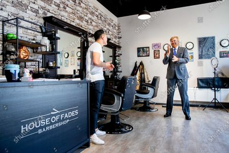 King Willem-Alexander during a working visit to the shopping center Stein where the king visited a hairdresser, optician, nail studio and physiotherapist.The entrepreneurs have contact professions and - after a period of forced closure - have started their company restart on 11 May during the corona crisis.