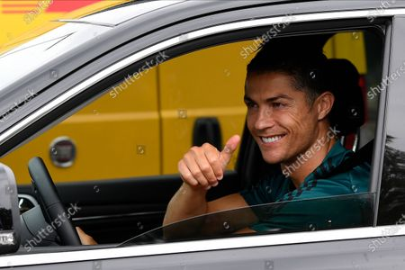Juventus' Portuguese forward Cristiano Ronaldo exit in his car to resume training after a quarantine on May 19, 2020 at the club's Continassa training ground in Turin, as the country's lockdown is easing after over two months, aimed at curbing the spread of the COVID-19 infection, caused by the novel coronavirus.