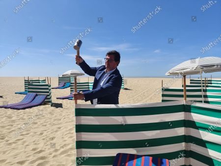 Illustration picture shows Oostende mayor Bart Tommelein at the Belgian coast in Oostende, as specific spaces on the sand are proposed as social distances measures to reopen the beaches, Tuesday 19 May 2020. Belgium is in its ninth week of confinement in the ongoing corona virus crisis.