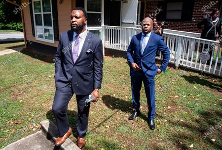 Lee Merritt, left, and Chris Stewart, attorneys for the mother of Ahmaud Arbery, are seen at a news conference, in East Point, Georgia. The attorneys appeared and spoke at a news conference held by the Atlanta branch of the NAACP. After a video of the shooting of Arbery emerged on social media, the Georgia Bureau of Investigation, arrested Gregory McMichael, 64, and his son, Travis McMichael, 34, and they were jailed on murder and aggravated assault charges