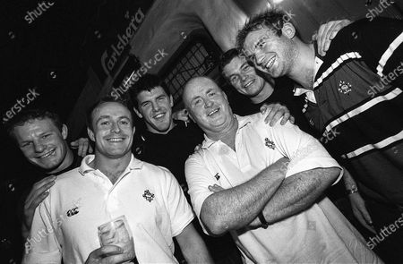 Stock Picture of Putting It On The Line 2002. Ireland. Singer Christy Moore with (L-R) Malcolm O'Kelly, Denis Hickie, Shane Horgan, Brian O'Driscoll and Gordon D'Arcy