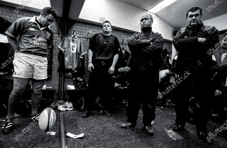 Putting It On The Line 2002. Ireland. (L-R) Kevin Maggs, Brian O'Driscoll, Declan Kidney (Asisstant Coach) and Jerry Holland in the dressing room before the game against Scotland