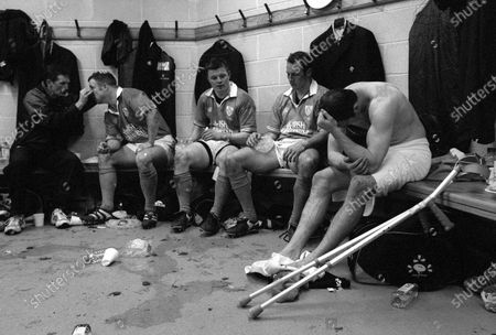 Six Nations Championship Ireland 2002. Kevin Maggs, Brian O'Driscoll and an injured Girvan Dempsey in the dressing rooms after defeat against England