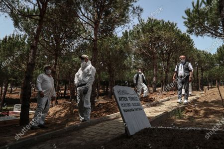 Cemetery workers wearing protective gear wait for the start of the funeral ceremony of Lutfiye Yilmaz, who died from COVID-19-related illness, at the Kilyos Cemetery in Istanbul, Turkey, 18 May 2020 (issued 20 May 2020). The toll from coronavirus-related deaths has risen in Turkey to 4,199 people as of 19 May 2020, with the country reporting 151,615 confirmed cases. Twenty-four healthcare and medical workers have died since the beginning of the outbreak, and more than 7,400 have been infected with the novel SARS-CoV-2 coronavirus that causes the COVID-19 disease. President Erdogan announced a curfew in 81 Turkish cities, including Istanbul, from 23 to 26 May 2020 to curb the spread of the ongoing pandemic. The lockdown coincides with the festival of Eid al-Fitr, which marks the end of the Muslim fasting month of Ramadan.
