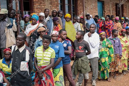 """Burundians queue to cast their votes in the presidential election, in Giheta, Gitega province, Burundi . A crucial election has begun in the East African nation of Burundi, where President Pierre Nkurunziza is stepping aside after a divisive 15-year rule but will remain """"paramount leader"""" in the country that continues to reject outside scrutiny"""