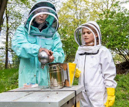 Princess Estelle tending to the beehives at Haga castle together with beekeeper Lotta Fabricius Kristiansen. The Crown Princess has been an honorary member of the Swedish Beekeepers' Association since 2002. The beehives at Haga was a wedding gift to the crown princess couple in from the Swedish Beekeepers' Association (SBR).