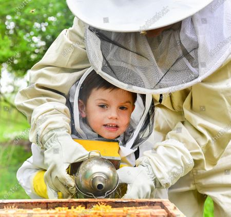 Crown Princess Victoria with Prince Oscar tending to the beehives at Haga castle. The Crown Princess has been an honorary member of the Swedish Beekeepers' Association since 2002. The beehives at Haga was a wedding gift to the crown princess couple in from the Swedish Beekeepers' Association (SBR).