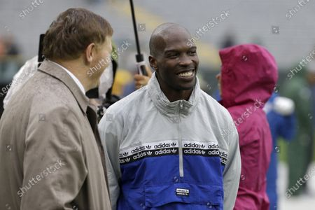 "Former NFL football player player Chad Johnson, right, talks with Green Bay Packers president and chief executive officer Mark Murphy before the start of a game between the Denver Broncos and Green Bay Packers in Green Bay, Wis. Chad Johnson left a whooping $1,000 tip for his waiter after dining at a restaurant in Florida that recently reopened amid the coronavirus outbreak. ""Congrats on re-opening, sorry about the pandemic, hope this helps. I LOVE YOU,"" Johnson wrote, on his $37 tab"