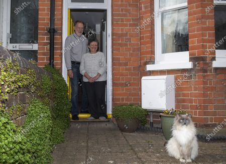 Keith and Kate Wright along with Alfie the cat stay home as Britons practice social distancing due to the coronavirus outbreak, in Berkhamsted, England