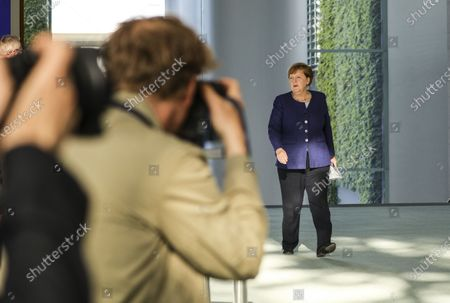 German Chancellor Angela Merkel (R) arrives to hold a press conference at the chancellery in Berlin, Germany, 20 May 2020. Chancellor Merkel informed about a video conference held with the chairs of international economic and financial organizations, aim to address issues caused by the spread of the coronavirus SARS-CoV-2 which causes the COVID-19 disease.