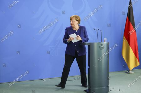 German Chancellor Angela Merkel leaves the podium after a press conference at the Chancellery in Berlin, Germany, 20 May 2020. Chancellor Merkel informed about a video conference held with the chairs of international economic and financial organizations, aim to address issues caused by the spread of the coronavirus SARS-CoV-2 which causes the COVID-19 disease.