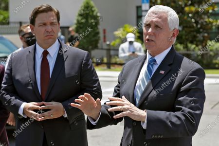 Vice President Mike Pence, right, gestures as he speaks to the media with Florida Gov. Ron DeSantis after delivering personal protective equipment to a Westminster Baldwin Park, in Orlando, Fla., as part of the initiative to deliver PPE to more than 15,000 nursing homes across America. Pence is also scheduled to participate in a roundtable discussion with hospitality and tourism industry leaders to discuss their plans for re-opening during the coronavirus outbreak