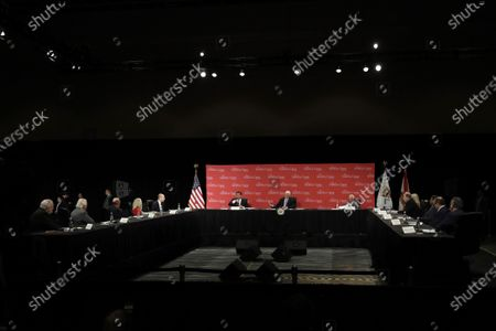 Vice President Mike Pence, center, participates in a roundtable discussion, in Orlando, Fla. The roundtable was held with hospitality and tourism industry leaders to discuss their plans for re-opening during the coronavirus outbreak