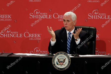 Vice President Mike Pence gestures as he participates in a roundtable discussion with hospitality and tourism industry leaders to discuss their plans for re-opening during the coronavirus outbreak, in Orlando, Fla
