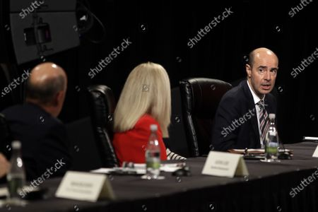 Secretary of Labor Eugene Scalia, right, participates in a roundtable discussion with Florida Gov. Ron DeSantis and Vice President Mike Pence, in Orlando, Fla. The roundtable was held with hospitality and tourism industry leaders to discuss their plans for re-opening during the coronavirus outbreak