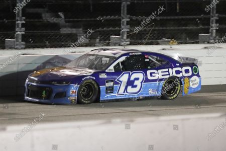 Ty Dillon (13) drives during the NASCAR Cup Series auto race, in Darlington, S.C