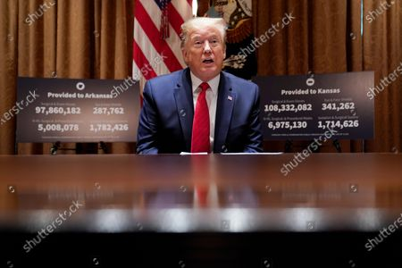 President Donald Trump speaks during a meeting with Arkansas Gov. Asa Hutchinson and Kansas Gov. Laura Kelly in the Cabinet Room of the White House, in Washington