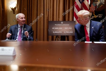 President Donald Trump listens during a meeting with Arkansas Gov. Asa Hutchinson in the Cabinet Room of the White House, in Washington
