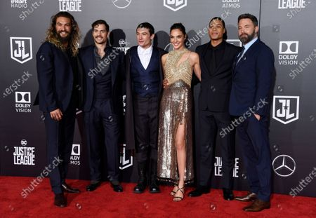 """The cast of """"Justice League,"""" from left, Jason Momoa, Henry Cavill, Ezra Miller, Gal Gadot, Ray Fisher and Ben Affleck, pose at the premiere of the film in Los Angeles. Warner Bros. Pictures say that director Zack Snyder's cut of the film"""" will debut next year on the streaming service HBO Max"""