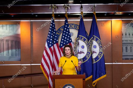 Stock Image of Speaker of the United States House of Representatives Nancy Pelosi (Democrat of California) speaks during her weekly press conference at the United States Capitol in Washington D.C., U.S.,.