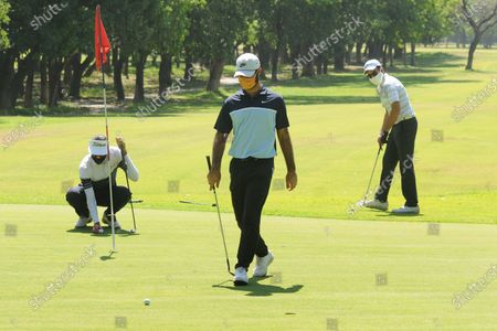 Professional golfers Rohan Kathuria (R), Karandeep Kochhar (L) and Shubhankar Sharma during a nine-hole round at Chandigarh Golf Club that has opened following relaxations in lockdown on May 20, 2020 in Chandigarh, India.