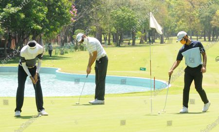 Professional golfers Rohan Kathuria (C), Karandeep Kochhar (L) and Shubhankar Sharma during a nine-hole round at Chandigarh Golf Club that has opened following relaxations in lockdown on May 20, 2020 in Chandigarh, India.