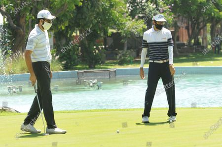 Stock Photo of Professional golfers Rohan Kathuria (L) and Karandeep Kochhar during a nine-hole round at Chandigarh Golf Club that has opened following relaxations in lockdown on May 20, 2020 in Chandigarh, India.